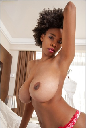 Ebony slut demonstrates her big tits in sexy glasses and red panties