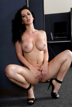 Jayden Jaymes shows off her big tits while wearing uniform in office
