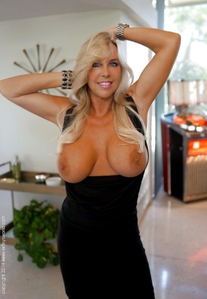 Mature housewife Sandra Otterson takes part in a sexy posing scene