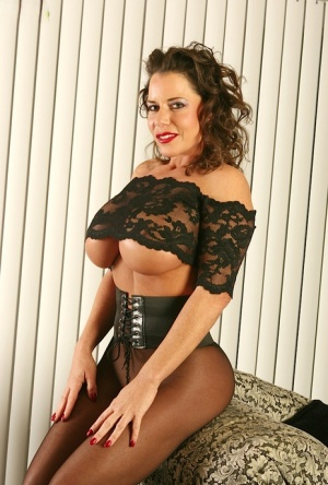 Pantyhose model Alicia DiMarc shows off her mature big tits