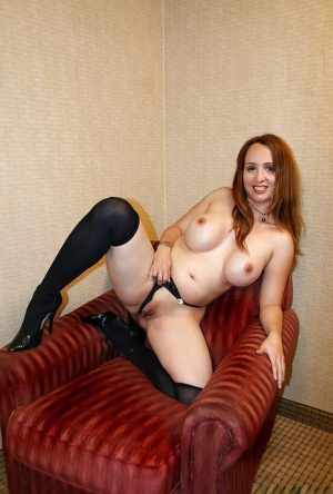Big tits milf Sophia Mouns shows off in high heels and stockings