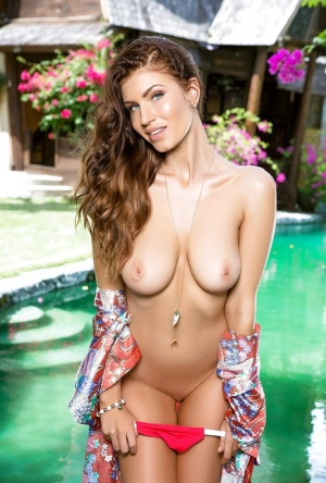 Centerfold babe with big tits Samantha Taylor showing off outdoor