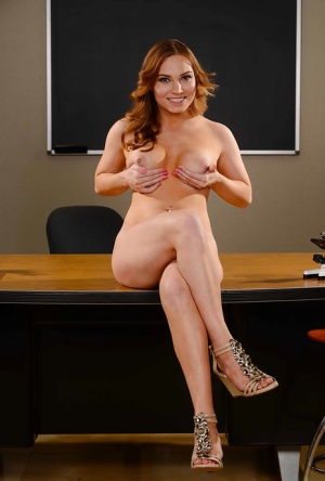 Slender redhead babe Tiff Bannister is spreading her long legs