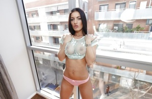 Glamour Latina Honey Demon takes off her t-shirt at the balcony
