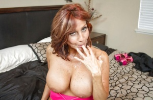 Big-tit redhead Tara Holiday is getting some sperm on her big boobies