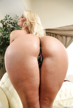 Milf blonde Phoenix Marie shows her ideal round big boobies and ass