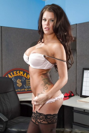 Office brunette Peta Jensen is taking off her clothes and masturbating