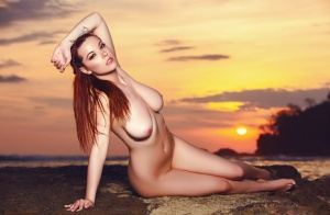 Babe Elizabeth Marxs poses on the beach and plays with big boobs