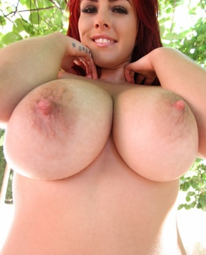 Big-tit chick Robyn Alexandra plays with her butts and nice pussy