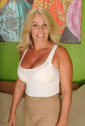 Mature blonde Crystal Taylor slowly takes off her tight skirt