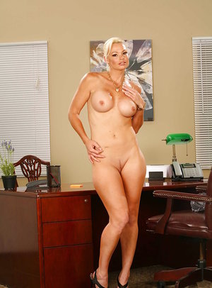 Glamorous blonde Rhylee Richards is playing with her tasty tits