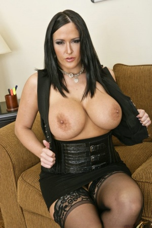Busty babe Carmella Bing shows her big boobs and her stretched pussy