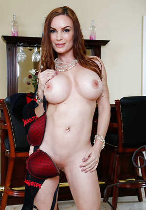 Hot babe and milf Daimond Foxx, undressing and enjoying as she is spreading her pussy