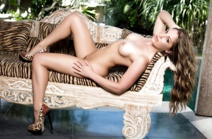 Hot centerfold babe Sarah Louise lets everyone see her chubby butt
