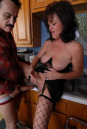 Dressed in sexy stockings granny Debella enjoy a deep pussy pounding