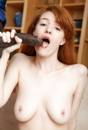 Redhead Abby Rains gets on knees to swallow a massive black dick