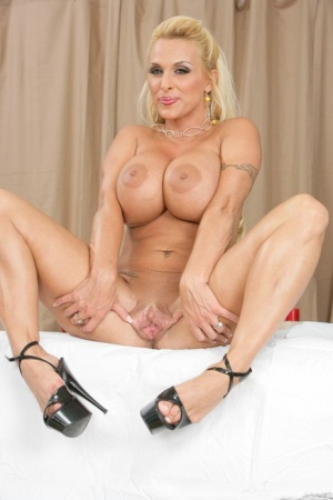 Blonde MILF with big melons Holly Halston spreading her hot cunt