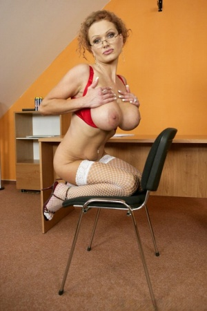 Big titted MILF in glasses Sharon Pink shows her sexy ass in stockings