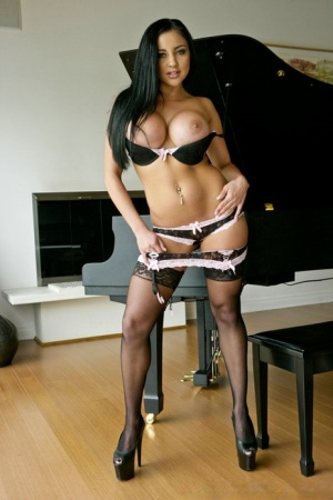 Pornstar babe in stockings Audrey Bitoni spreads her tender pussy