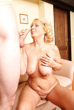 Horny mature cougar Regi eagerly sucking on the plumbers cock
