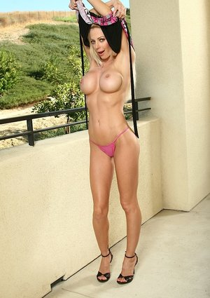 Busty blonde model Holly gets naked outdoors and spreads pussy