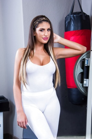 Busty pornstar August Ames showing off her big ass and spreading