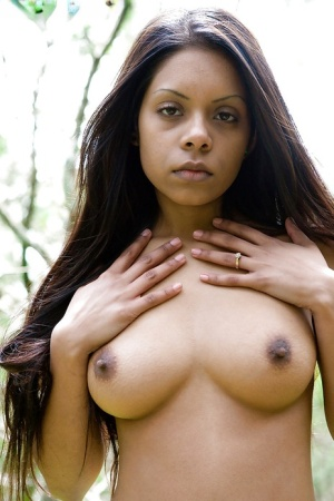 Exotic amateur babe Kiki flashing all natural tits and hairy pussy outdoors