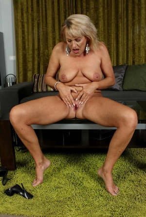Older blonde lady Andrea makes her nude modelling debut and masturbates too