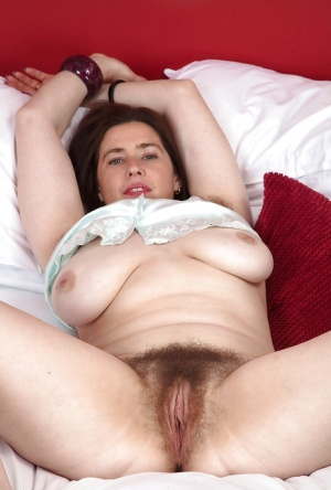 Stunning mature brunette Janey stroking and spreading her hairy cunt