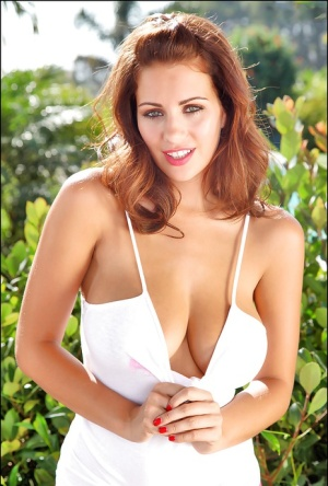 Busty babe Holly flashing and fondling her big natural tits outdoors