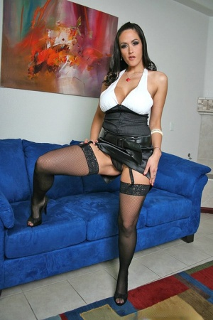 Busty babe Carmella Bing posing in high heels and lace top stockings