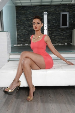 Mature ebony housewife Halona Vouge posing in tight ass hugging dress