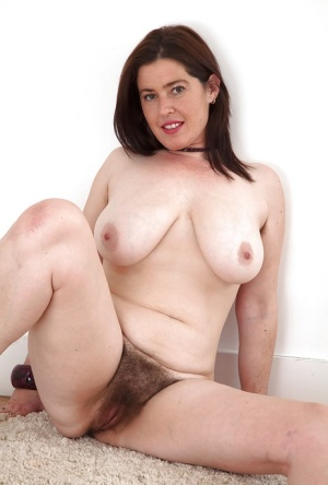 Over 30 mom Janey lets her large breasts loose before flashing hairy cunt
