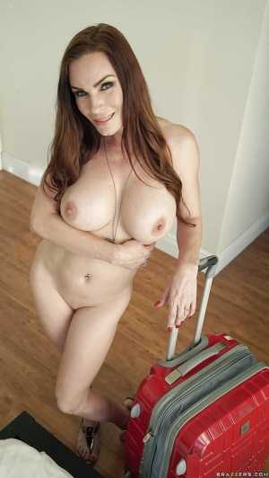 Big boobed beauty Diamond Foxxx displaying large hanging breasts