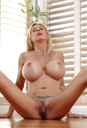Buxom mature MILF Brooke Tyler exposing shaved vagina for close ups