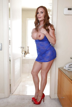 Redheaded mom Diamond Foxxx lets huge juggs loose from dress
