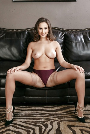 Hot secretary Ashley Adams removes blouse and skirt to pose in underthings