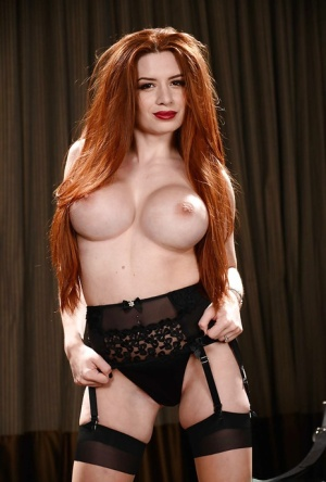 Redheaded MILF Veronica Vain modelling sexy lingerie and stockings