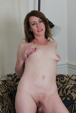 Aged solo model Joanie Bishop and her small saggy tits posing nude