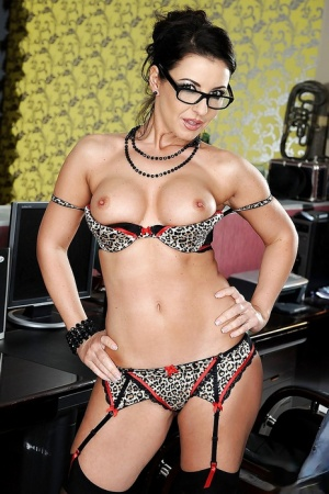 Sexy secretary in glasses strips to lingerie and shows MILF pussy
