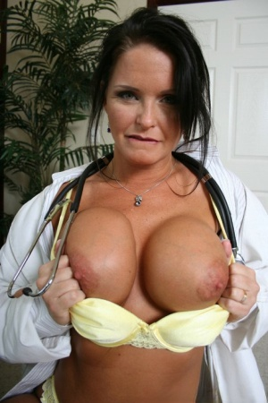 Mature doctor in uniform Megan Monroe spreading shaved pussy