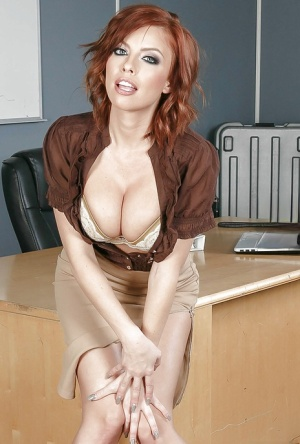 Buxom redheaded teacher Britney Amber flashing cleavage in tight blouse