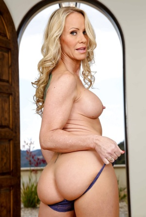 Older blonde mom Simone Sonay removes lingerie for nude pics