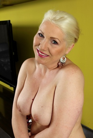 Chunky older blonde woman Netty showing off nice mature juggs