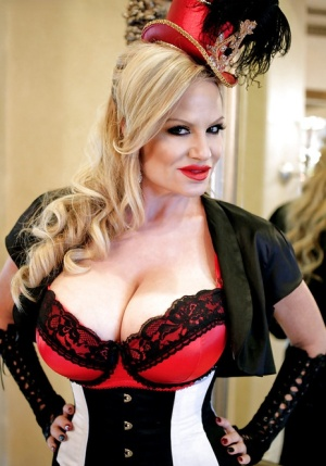 Older blonde MILF Kelly Madison modeling fully clothed in retro outfit