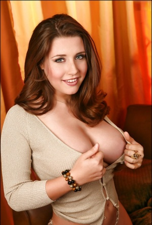 Chesty solo babe Erica Campbell releasing huge boobs from thin sweater