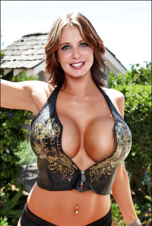 Chesty solo babe Brandy Robbins flaunts her large MILF breasts