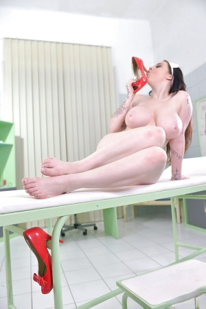 Hot brunette nurse Harmony Reigns toying pussy with heel of own shoe