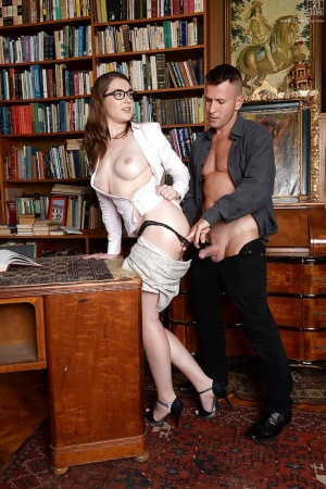 Nerdy librarian Nadia Bella freein nice melons while giving bj in library