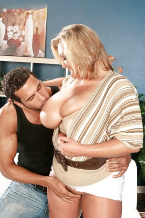 Chubby cocksucker Anna Kay teasing erected shaft with her boobs and wet snatch